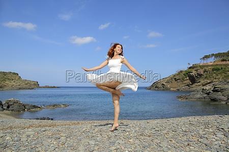 happy tourist on the beach celebrating