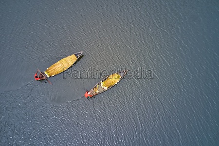 aerial view of two canoe sailing