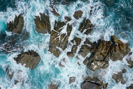 aerial view of waves crashing on