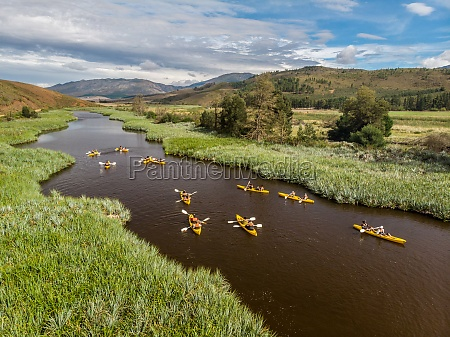 aerial view of yellow kayaks on