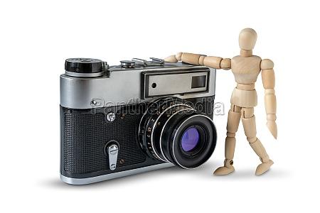 retro film camera and wooden mannequin