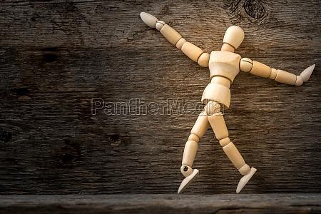 wooden man in dancing pose