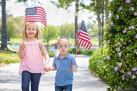 young sister and brother waving american