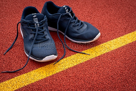 running shoes are placed beside the