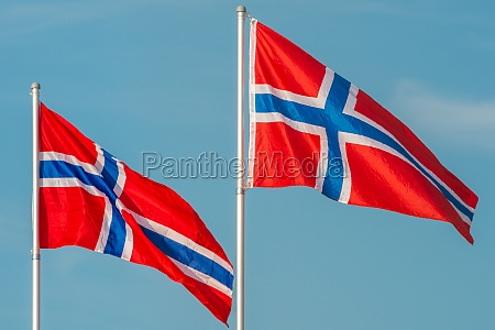 norway flags blowing in the wind