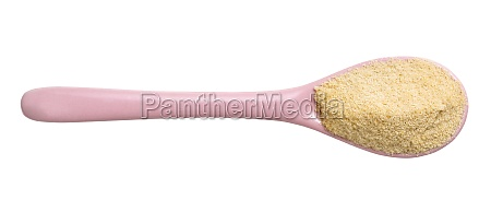 granulated coconut sugar in pink ceramic