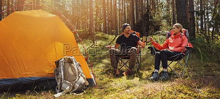 forest camping young hiker couple