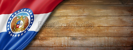 missouri flag on old wood wall