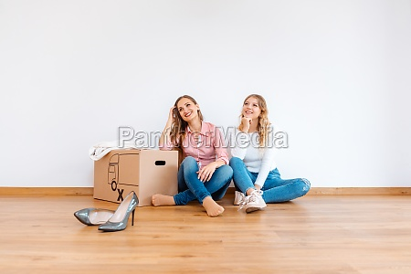two women in new apartment dreaming
