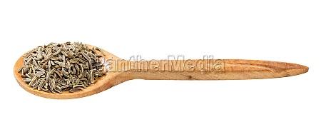 wooden spoon with kala zeera seeds