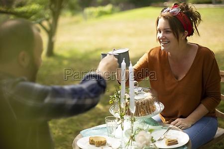 happy couple enjoying tea and cake