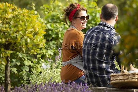couple taking a break from gardening