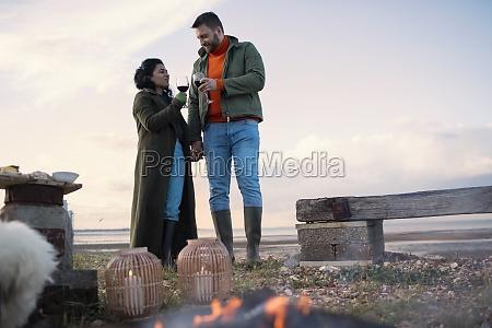 couple in winter coats enjoying red