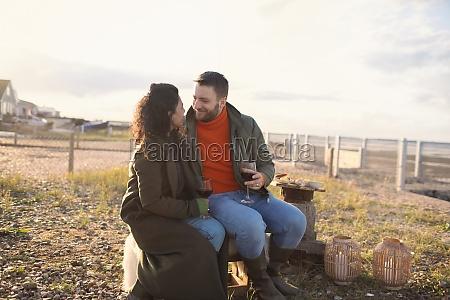 happy romantic couple enjoying wine by