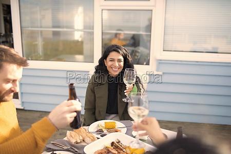 happy woman enjoying wine and seafood