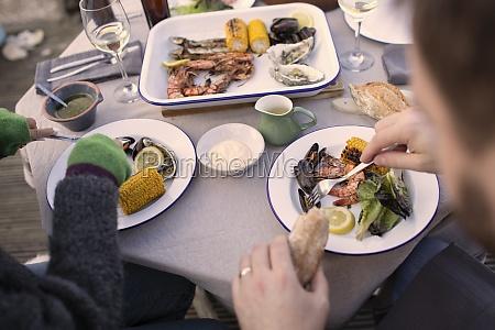 couple enjoying fresh seafood on patio