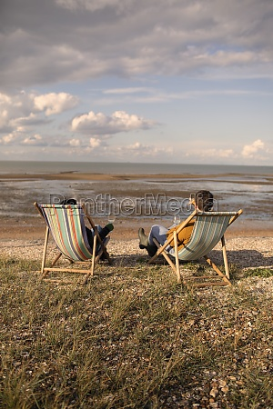 couple relaxing with wine in beach
