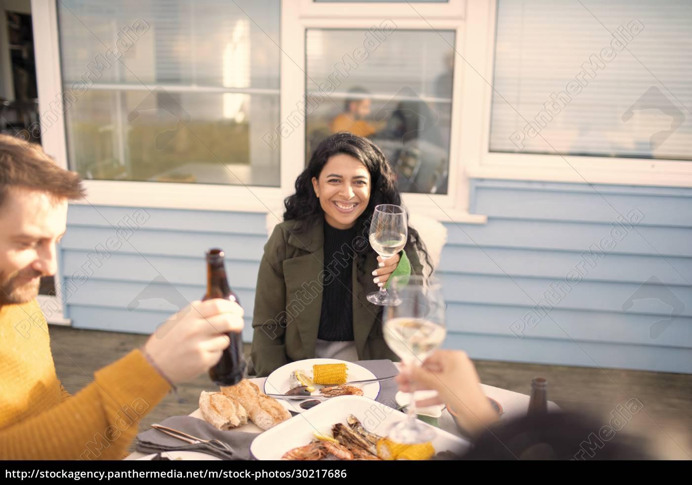 happy, woman, enjoying, wine, and, seafood - 30217686