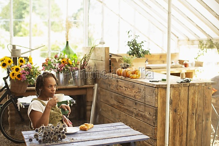 female florist taking coffee break in