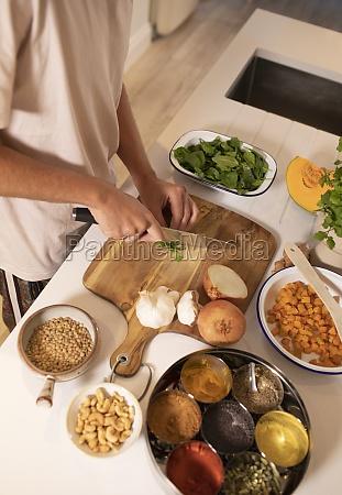 man cooking slicing fresh vegetables