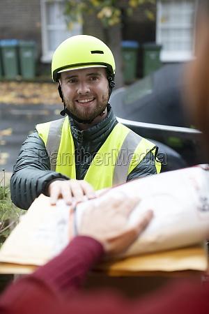 friendly male bike messenger in helmet