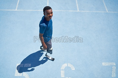 portrait confident young male amputee athlete