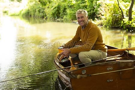 portrait happy man with coffee fly