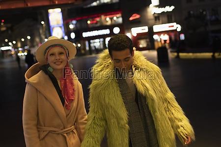 portrait fashionable couple on city street