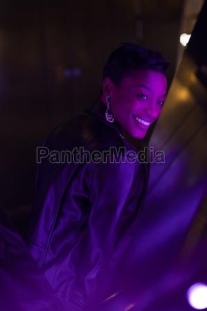 happy beautiful young woman at dark