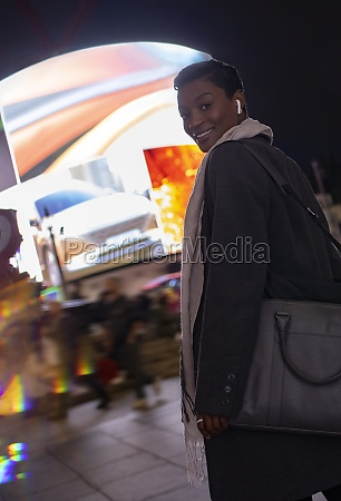 portrait young woman walking on city