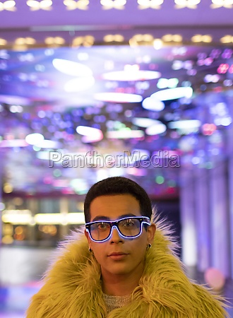 portrait stylish young man in feather