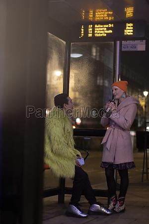 stylish young couple talking at city