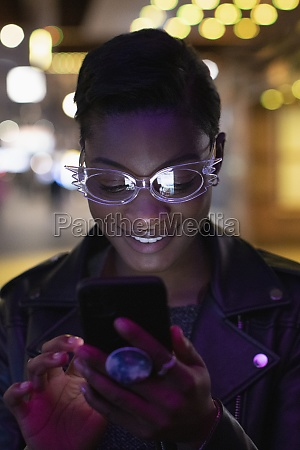 young woman in funky eyeglasses using