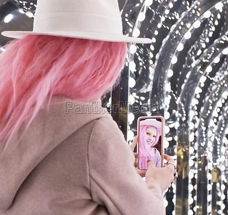 beautiful stylish woman with pink hair