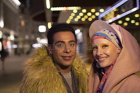 portrait stylish happy couple in city