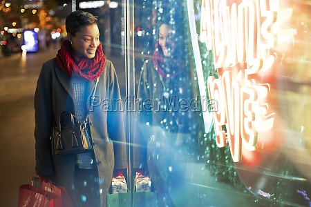 young woman shopping at urban neon