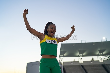 happy female track and field athlete