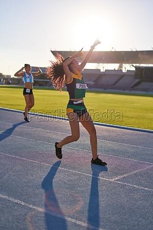 female track and field athlete celebrating
