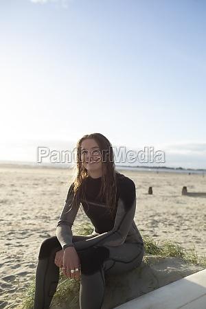 portrait confident beautiful young female surfer