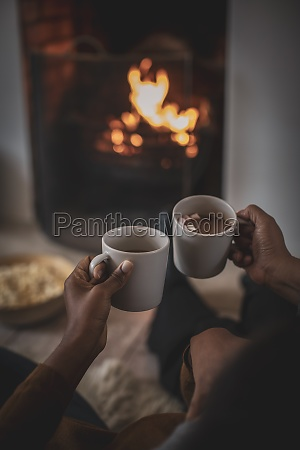 mother and daughter enjoying hot cocoa
