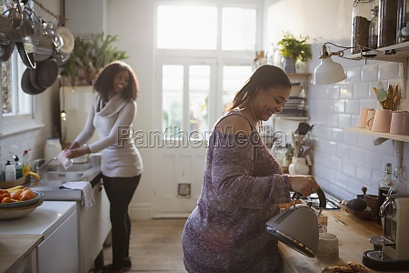 mother and daughter doing dishes and