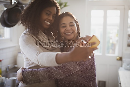 happy mother and daughter hugging and