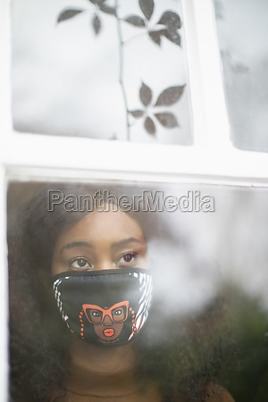 thoughtful woman in face mask at