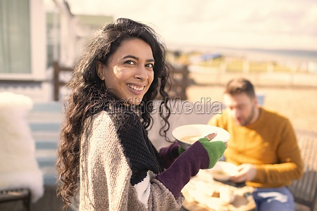 portrait happy woman eating on sunny