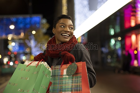 happy young woman christmas shopping in