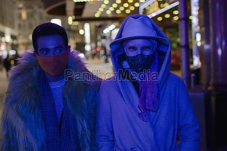 portrait stylish couple wearing face masks