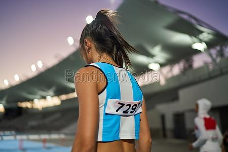 female track and field athlete preparing