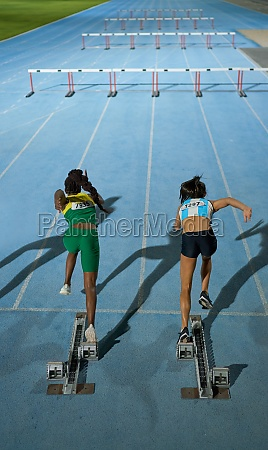 female track and field athletes starting