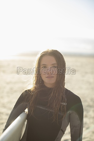 portrait beautiful young female surfer with