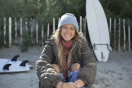 portrait happy beautiful young female surfer